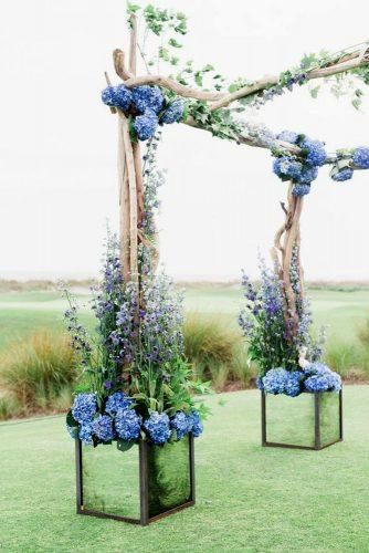 blue wedding theme arch with blue flowers