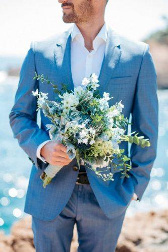 blue wedding theme blue groom suit groom with flower