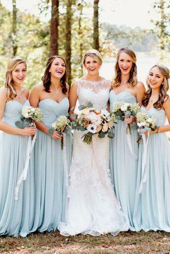 blue wedding theme bride and bridesmaids in blue dresses in forest