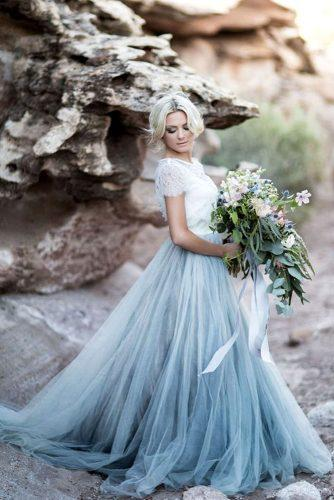 blue wedding theme bride in blue dress on beach