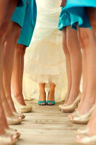 blue wedding theme bride in blue shoes with bridesmaid in gold shoes