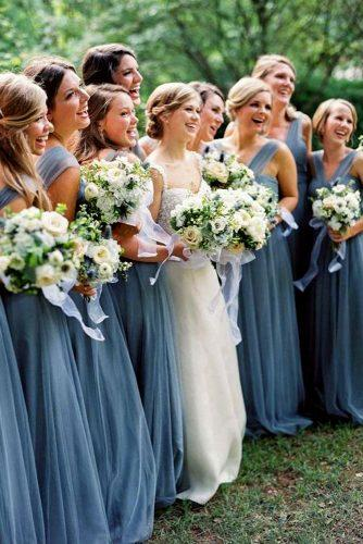 blue wedding theme bride with bridesmaids in blue dresses with bouquets
