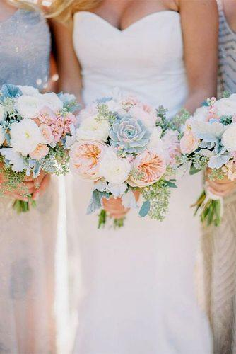 blue wedding theme bride with bridesmaids with pink and blue bouquets