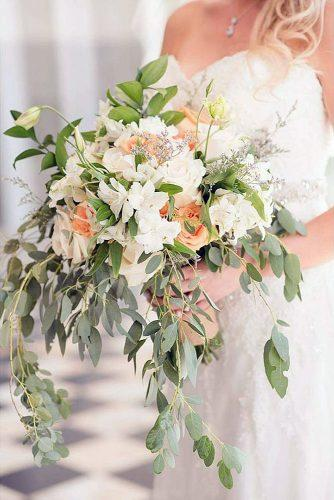green wedding florals bouquet with greens white lilies and orange roses holly d via instagram