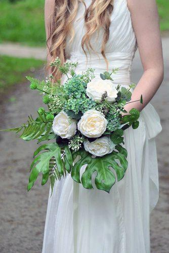 green wedding florals bouquet with large green leaves and large white peonies innocent chaos via instagram