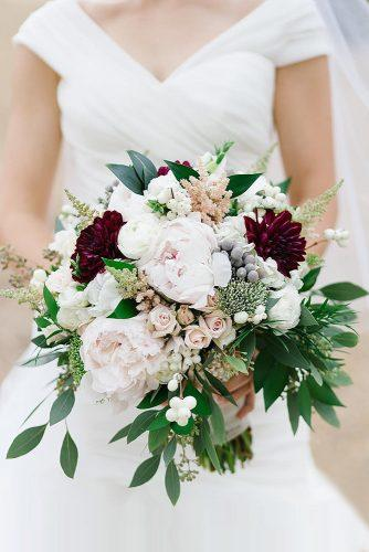 green wedding florals bouquet with roses of a peony burgundy dahlias and greens lidia codrean via instagram