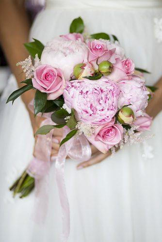 pink wedding bouquets with peonies roses astilbe and greens tied with a pink ribbon krista patton photography