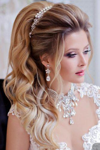 swept back wedding hairstyles half up half down-with-accessories komarova websalon