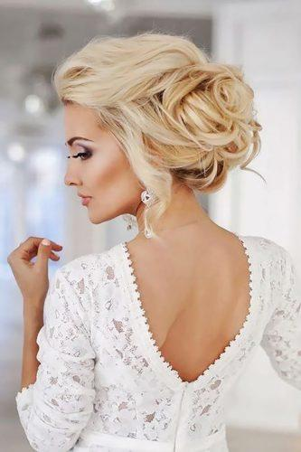 swept-back wedding hairstyles stunning messy updo elstile