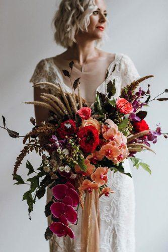wedding bouquet ideas cascading with wildflowers and orchids peggysaas via instagram