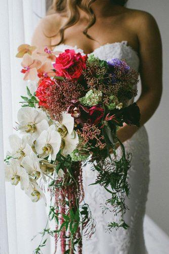 wedding bouquet ideas inspiration cascade with white and red orchids greenery natasjakremers via instagram