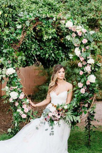 wedding greenery arch idea round with flowers rayann lindsey photography