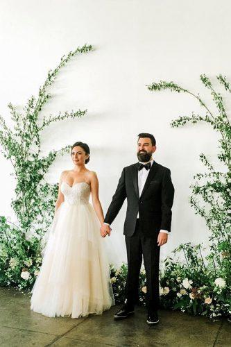 wedding greenery backdrop groom bride lavenders florals
