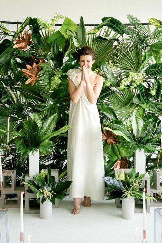 wedding greenery exotic backdrop and bride