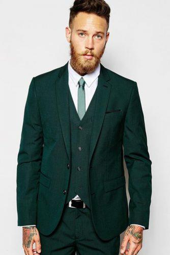 wedding greenery groom with tatoo in green suit asos