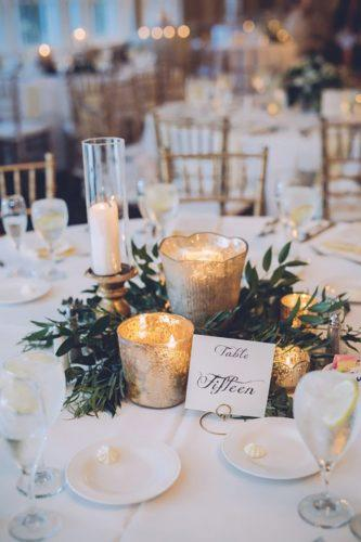 wedding table decorations greenery-centerpiece-with candles danielle nowak