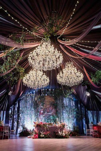 wedding tent a mystical atmosphere with elegant chandeliers of green garlands and flowers flowerbazar via instagram