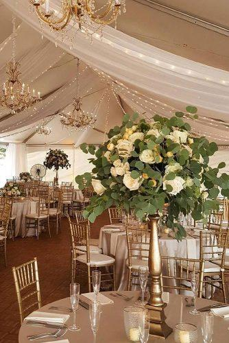 wedding tent elegant reception in beige and gold colors with electric garlands and white roses design light via instagram