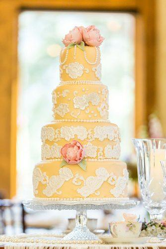 elegant wedding cakes yellow cake in vintage style decorated with white patterns of white beads and pink peonies kristopher lindsay photography