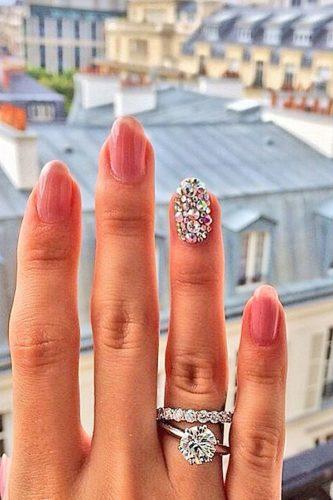wedding proposal ideas ring-selfy against the town view