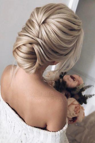 wedding updos for long hair elegant low bun alexandra poslavskaya