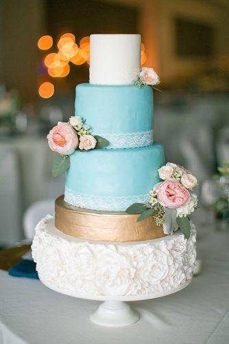 beautiful wedding cakes tall blue white and gold cake decorated with lace and pink flowers nicole lapierre photography