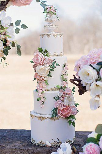 beautiful wedding cakes tall white with flowers and gold finecakesbyzehraofficial