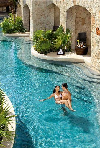 best all inclusive honeymoon couple in pool secretsresorts