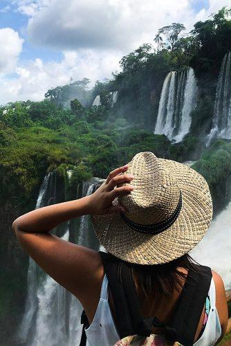 best honeymoon spots argentina girl watching waterfall
