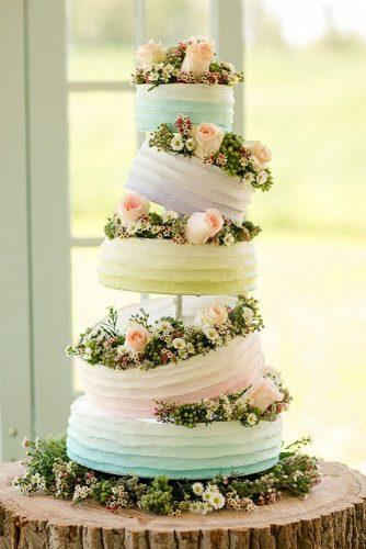 buttercream wedding cakes colorful ombbre tall cake decorated with roses katelyn james photography