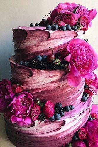 buttercream wedding cakes pink with blueberries and mulberries with flowers of peonies and roses stefani pollack via instagram