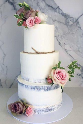 buttercream wedding cakes rustic tall white with pink roses and green leaves blondebakingmama via instagram