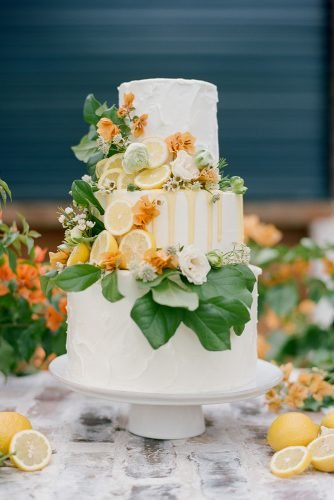 buttercream wedding cakes three tiered white with lemons leaves and drip dana fernandez photography