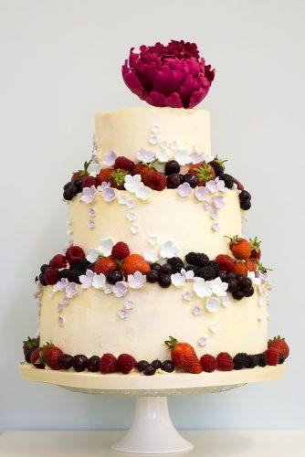buttercream wedding cakes with berries and peony on top rosalindmillercakes via instagram