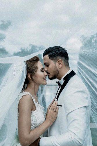 creative wedding kiss photos bride and groom under the veil soheil r a d via instagram