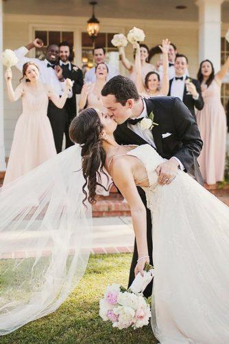 creative wedding kiss photos bride and groom with guests liz erikson photography