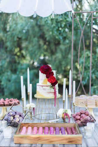 elegant wedding cakes cake in bohemian style decorated with a cascade of claret flowers alison d photography