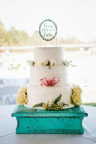 elegant wedding cakes simple cake in bohemian style decorated with fresh flowers mark williams studio
