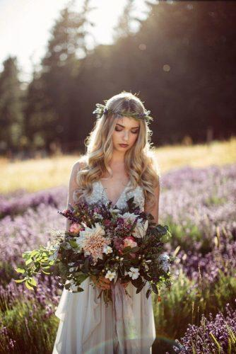 fall wedding bouquets lush cascade with herbs and flower dahlias in the hands of the bride in a wreath on a lavender field rivkah photography
