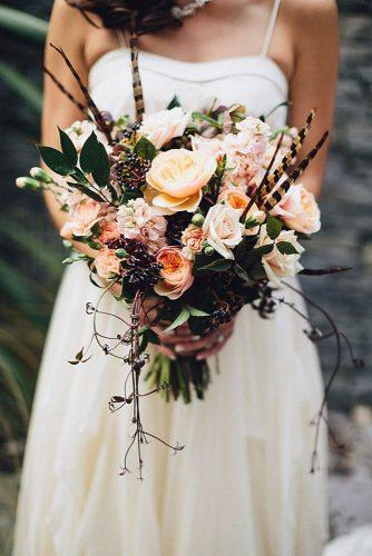 fall wedding bouquets with gentle autumn flowers and feathers chaz cruz