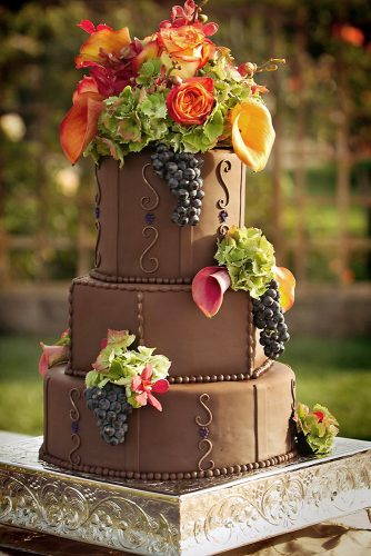 italian wedding cakes chocolate cake decorated with flowers and grapes lets do cake