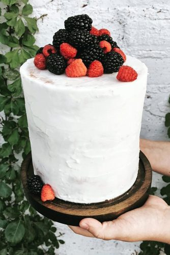 italian wedding cakes cream with berries of raspberry and mulberry on a wooden stand katlyn gruber via instagram