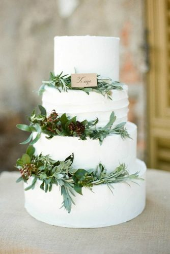 italian wedding cakes white decorated with greenery vierlieft photography