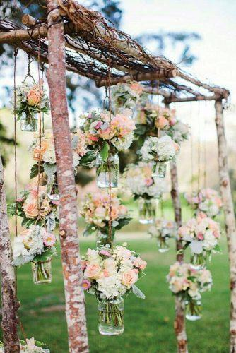 shabby chic vintage wedding decor ideas wooden arch decorated with suspended flower jars rebecca arthurs photography