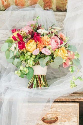 summer wedding bouquets bright with pink and yellow roses and dahlias michelle renee photography via instagram