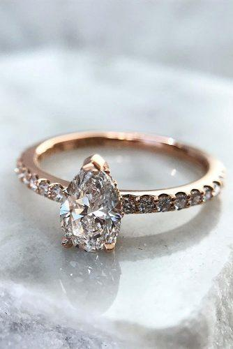 top engagement ring ideas pear cut pave band rose gold