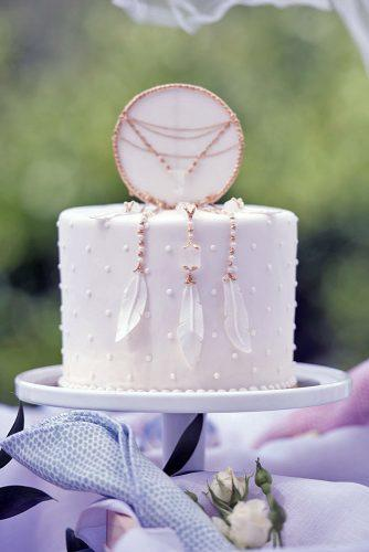 unique wedding cake toppers beautiful white cake with a top in the form of a dream catcher blush wedding photography