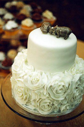unique wedding cake toppers couple of hippopotami from ceramics on the top of a white cake kendra elise photography