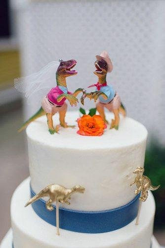 unique wedding cake toppers figurines of the bride and groom dinosaurs brooke price photography