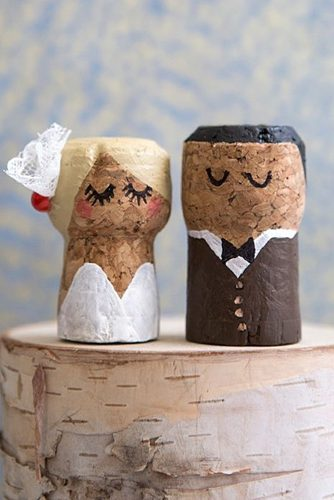 unique wedding cake toppers from wine corks figures of the groom and the bride jen carreiro of something turquoise